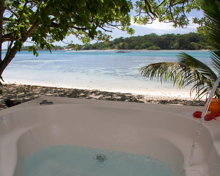 Beachfront Deluxe Spa Villa - 2 person Spa on the deck where you can relax and enjoy the amazing views