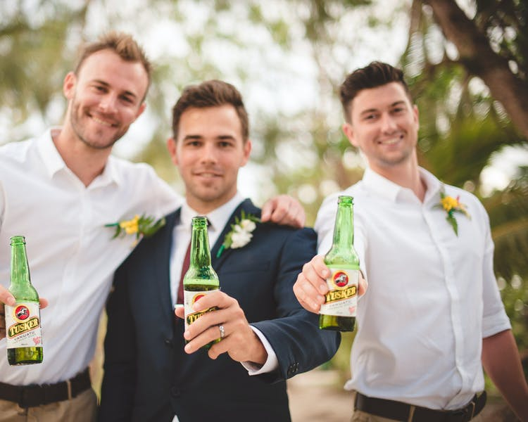 Groom & Groomsman with Tusker beer. erakor island resort Vanuatu tourism