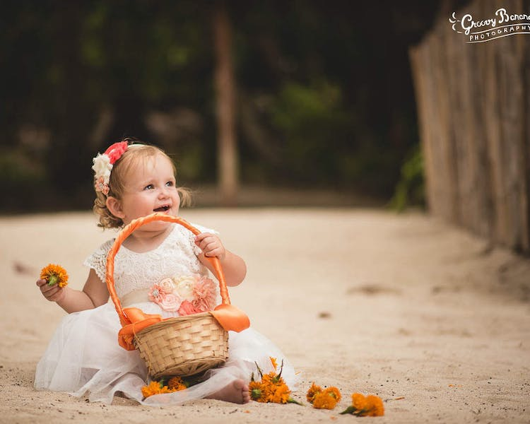 Flowergirl with petal basket on Calypso Beach#erakorbeachweddings#weddingceremonyonthebeach #erakorbridalbouquet