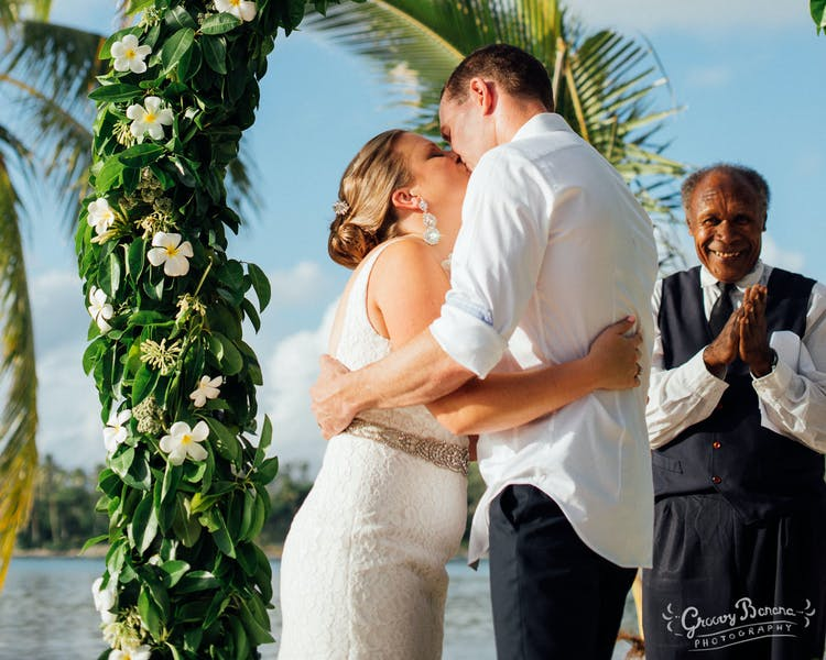 Coconut Beach with a beautiful Floral Arch #erakorweddings #weddingceremonyonthebeach #Vanuatutropicalbeachweddings