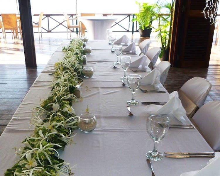 Aqua on Erakor Overwater Restaurant Bridal Table Floral Decor #erakorbeachweddings #weddingreceptionthebeachsouthpacific #Van