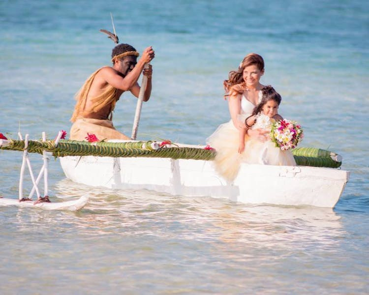 Bride & Flowergirl on the Outrigger Canoe #erakorbeachweddings #weddingceremonyonthebeachsouthpacific