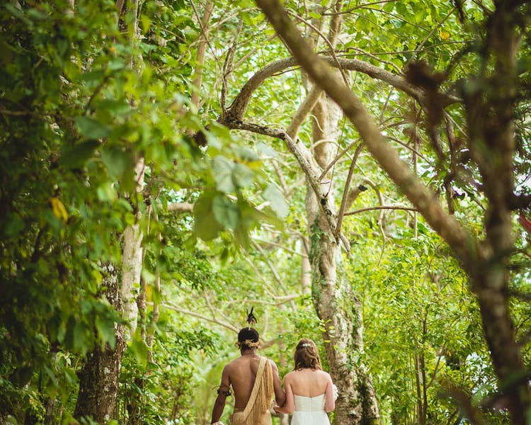 Tropical Island Wedding Aisle bridal arrival warrior escort #erakorbeachweddings #weddingceremonyonthebeachsouthpacific