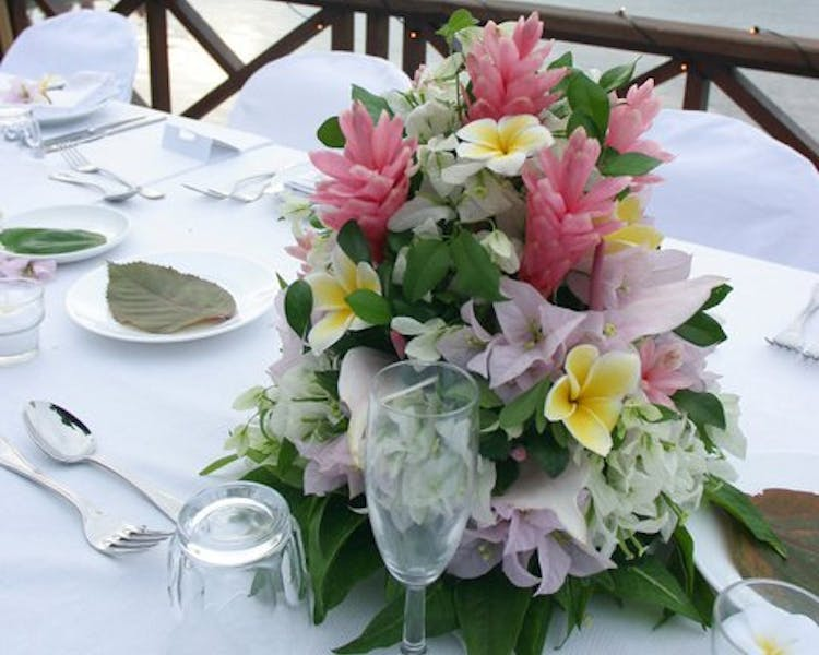 Wedding Reception Floral Centerpiece #erakorbeachweddings #weddingreceptionthebeachsouthpacific #Vanuatutropicalbeachweddings