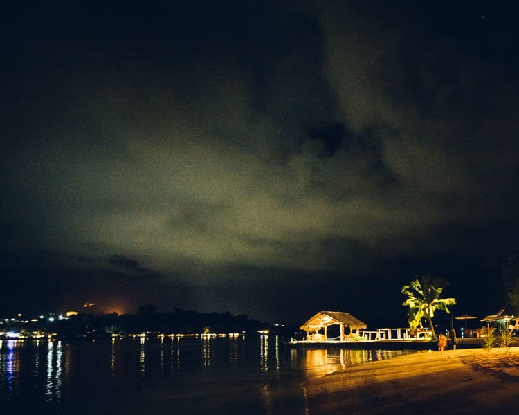 Erakor Island Calypso Beach view by night #erakorbeachweddings #weddingreceptionthebeachsouthpacific