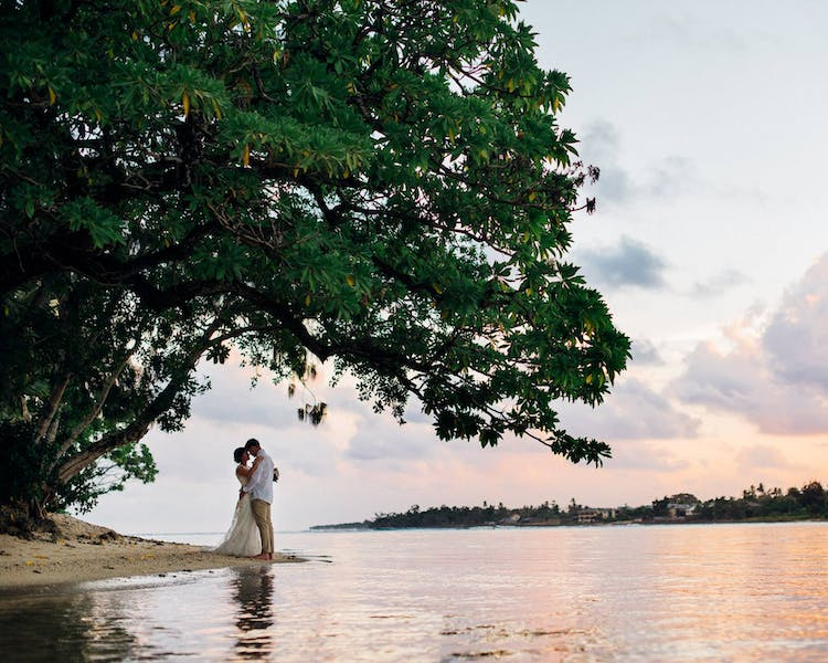 Sharing a romantic moment on Sunset Beach #erakorbeachweddings #weddingceremonyonthebeachsouthpacific #Vanuatu