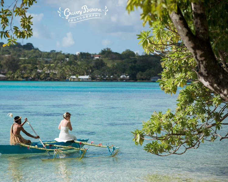 Arrive to your wedding on a traditional Outrigger Canoe bridal arrival #erakorbeachweddings #weddingceremonyonthebeach