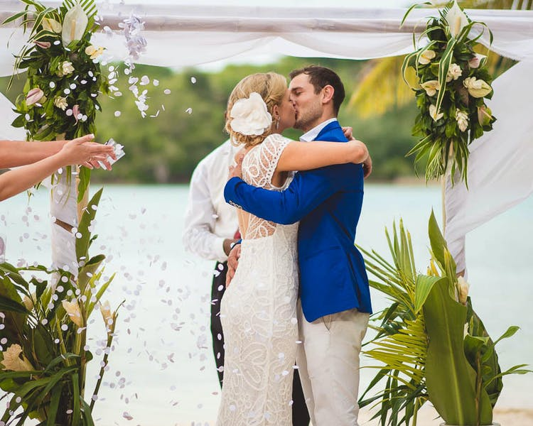 Bamboo Canopy and tropical blooms #erakorweddings #weddingceremonyonthebeach #Vanuatutropicalbeachweddings