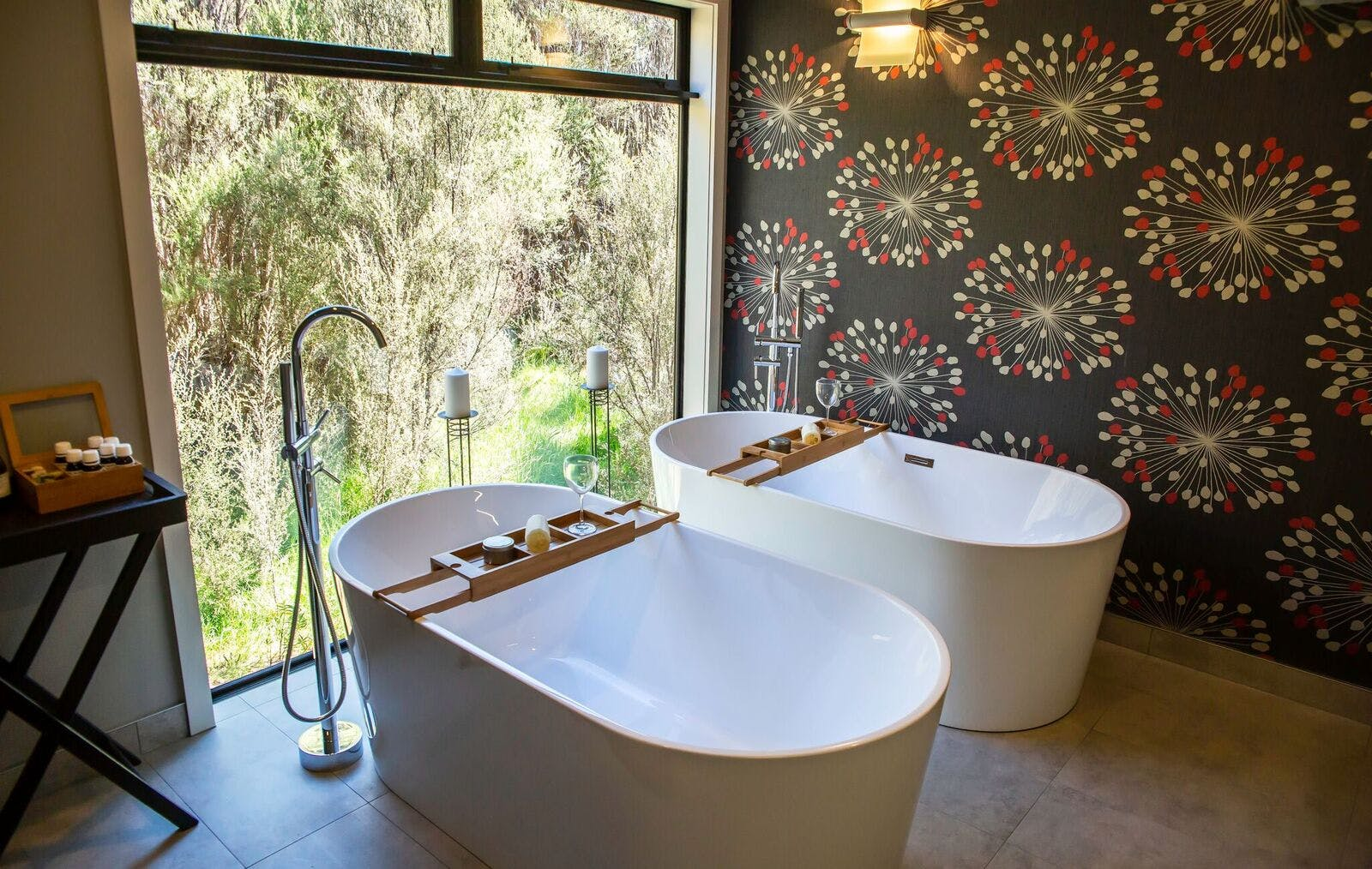 Twin baths with bush view