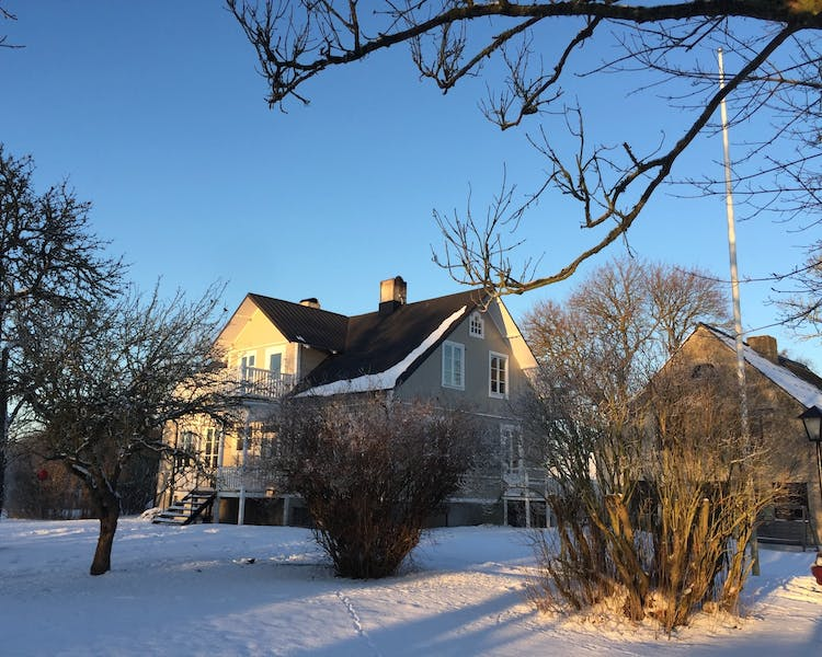 Side view of boutique bed and breakfast in snowy winter