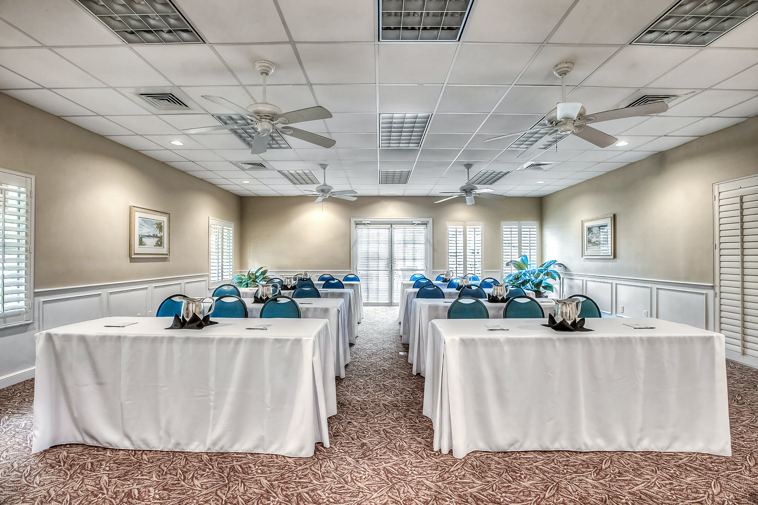 Tuscan Room meeting space with classroom-style setup with view of windows