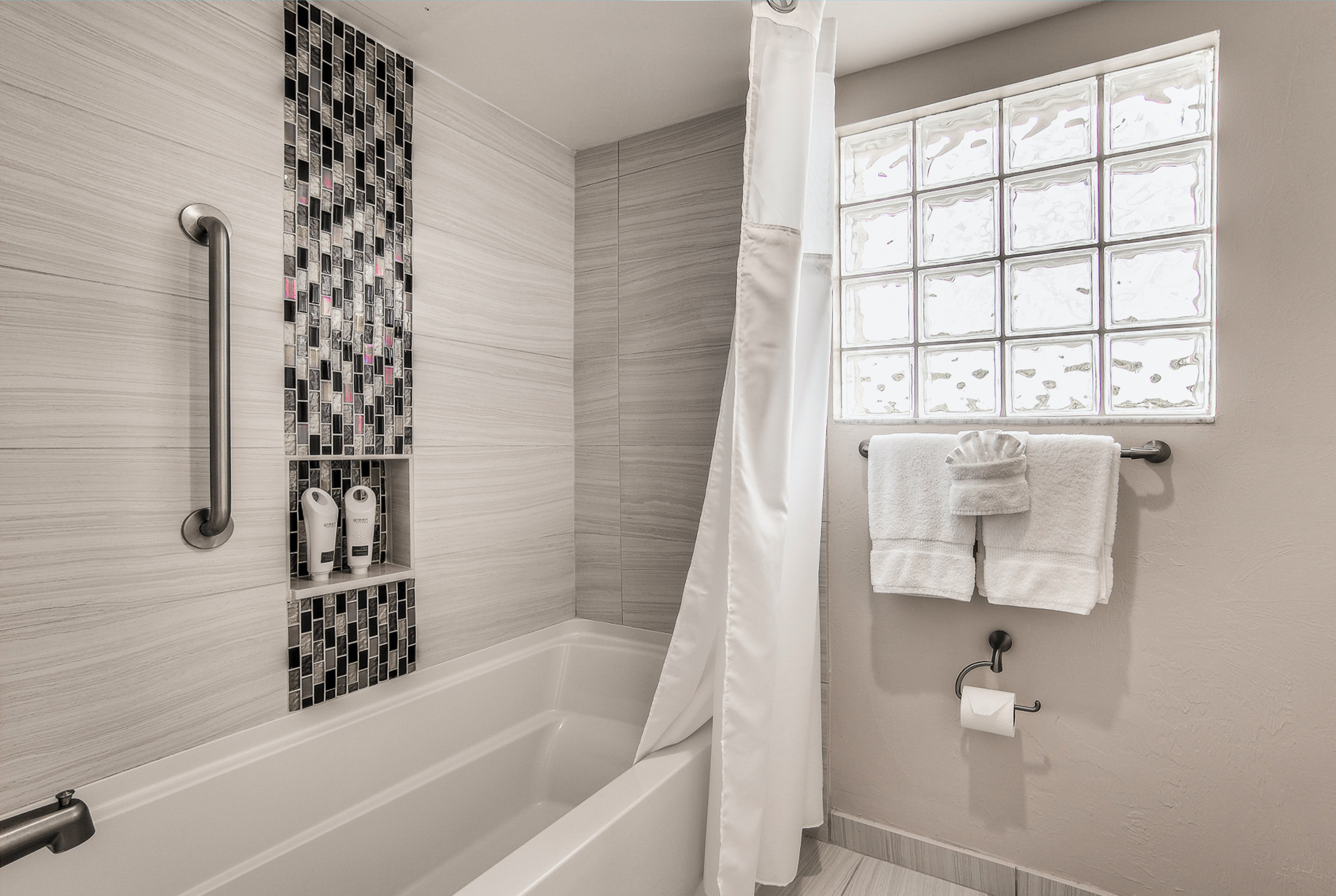 Standard guest bathroom with tub/shower combo