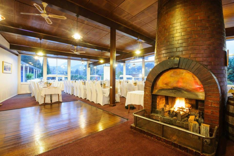 Restaurant dressed for function, fire lit