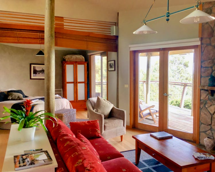 Open plan living with french doors leading to the deck at Taronga