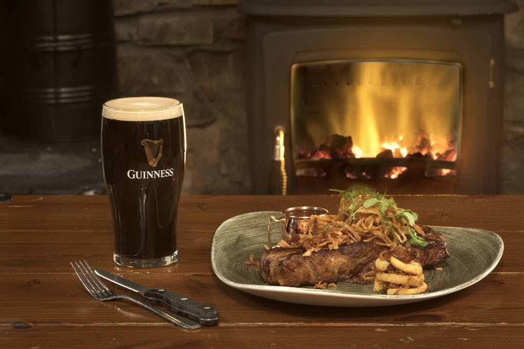 guinness with a steak by the fire