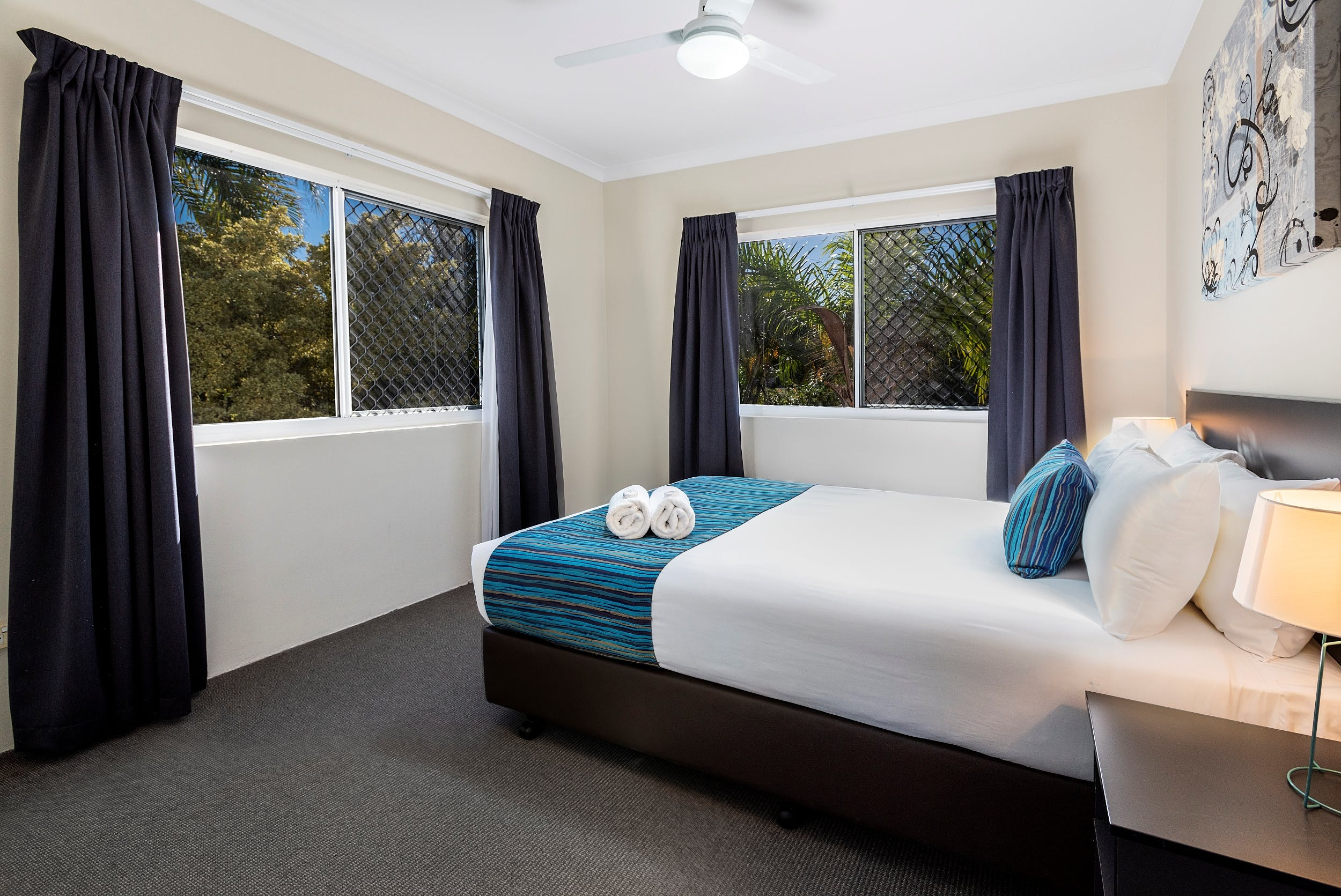 Upstairs Queen room in our self contained townhouse on the Beach in Hervey Bay