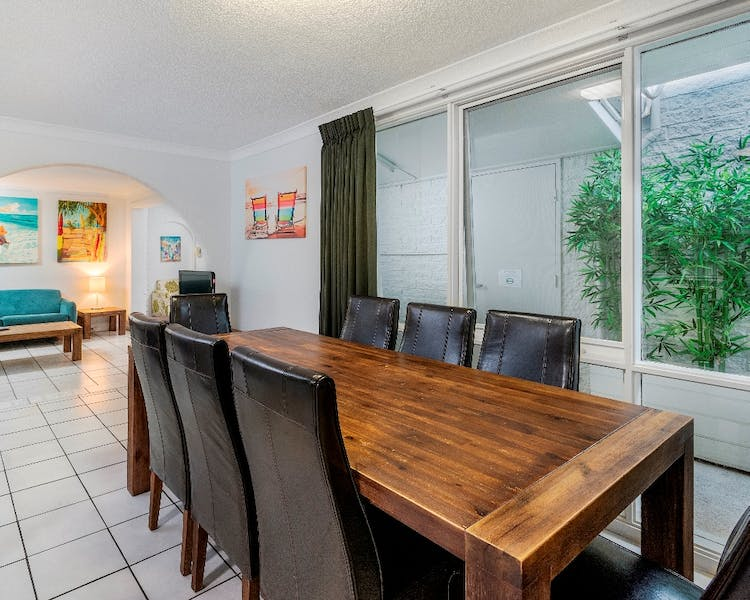 Large dining area in the apartment, suitable for groups or long stays in Hervey Bay
