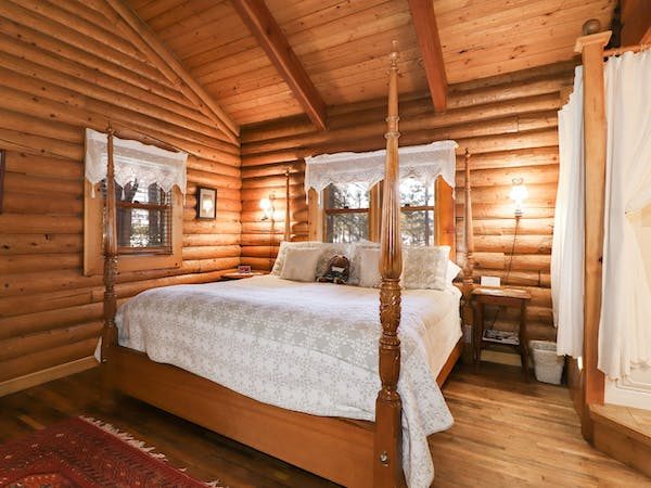 King suite with sitting area, wood burning fireplace, & ensuite bathroom