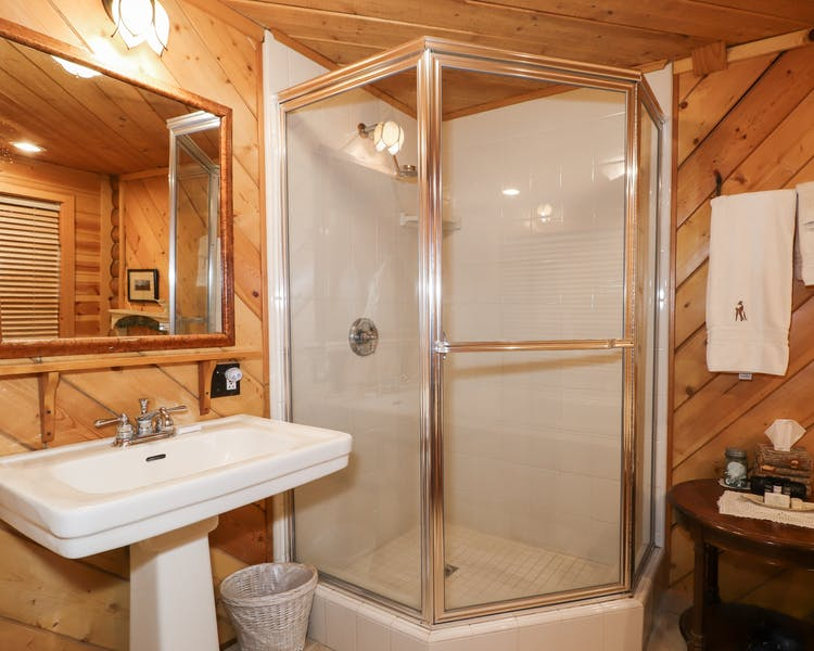 A large ground floor suite with 2 person jetted tub & separate shower