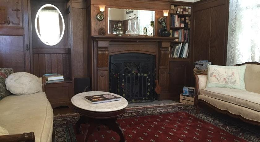 Fireplace and table in parlor