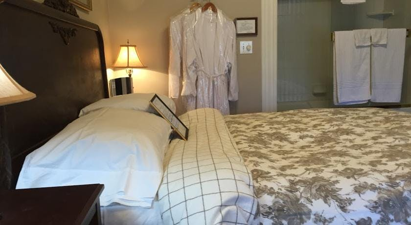 Luxurious Robes and queen bed in Tuolumne Room