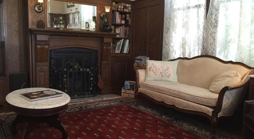 Fireplace and love seat in parlor