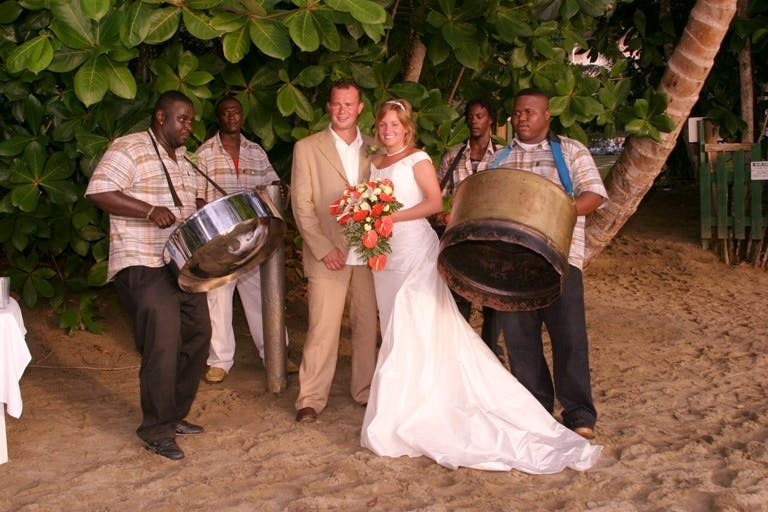 Toes in the sand, enjoying steel band music, makes perfect wedding