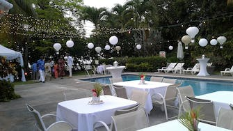 Pool area set for an evening wedding
