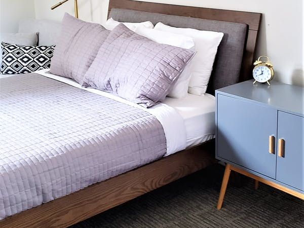 Luxury hotel room bed and nightstand Beulah Michigan