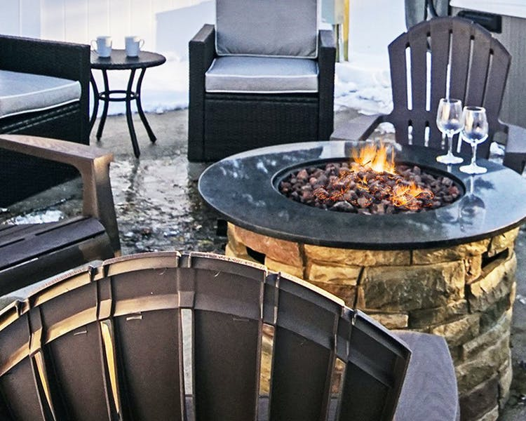 Outdoor fire table Coastal Suites Resort Michigan