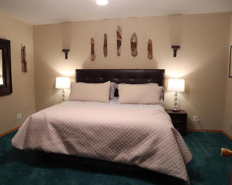 Geronimo room with king bed, dresser , closet and smart tv.