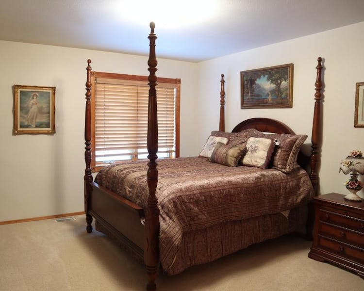 The Queen Suite with four poster queen bed, dresser, large closet and private bathroom right outside your door.