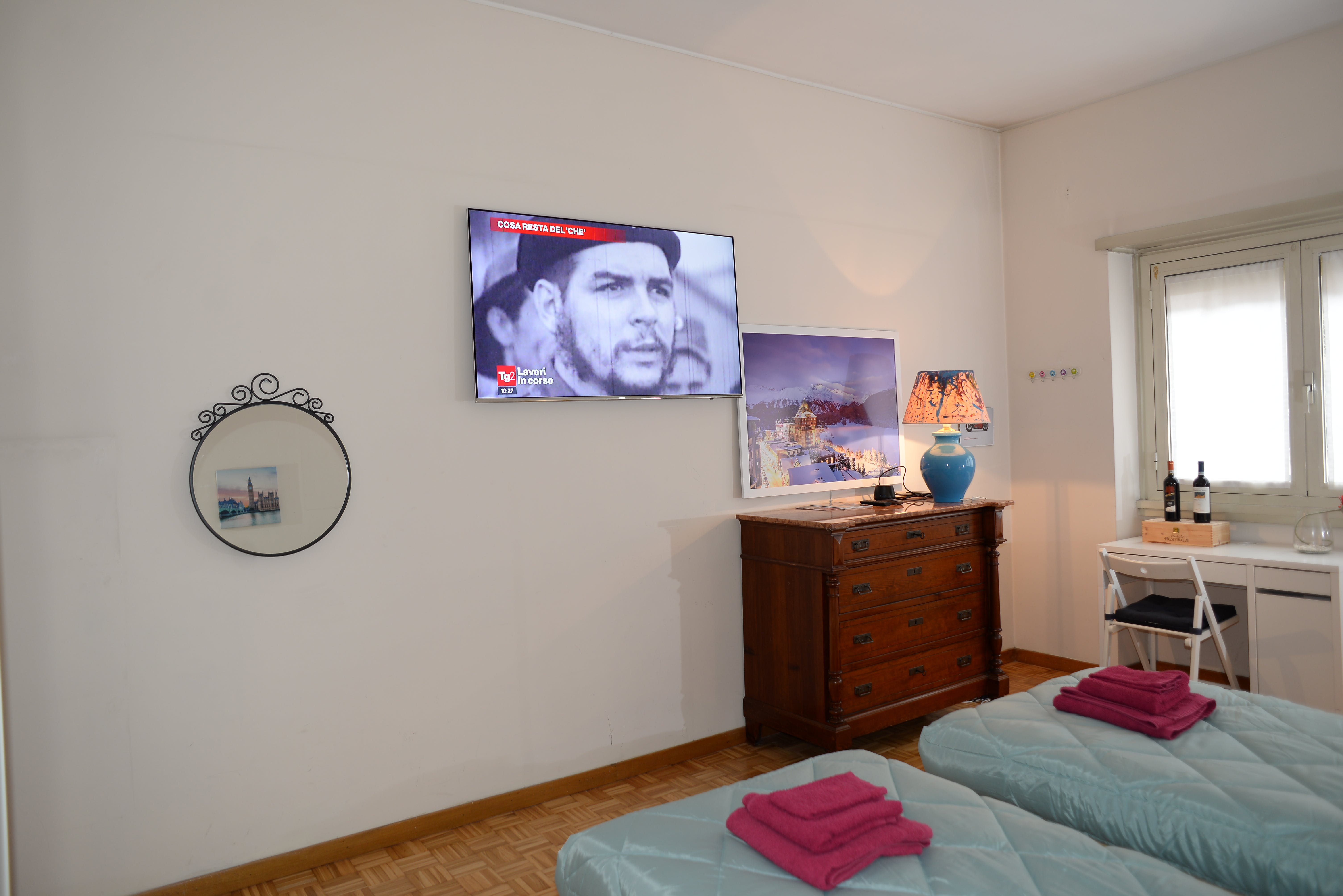 Deluxe White Room with Samsung Television 55 inches