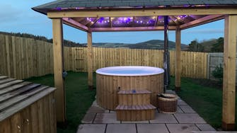 Fairy lights night time wood fired hot tub