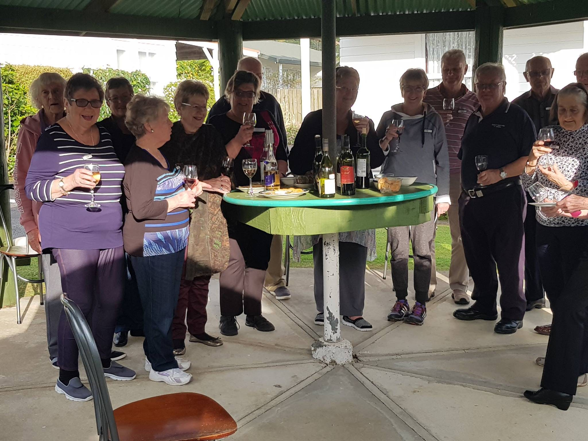 Guests enjoying a wine in a pergola