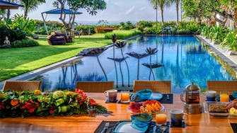 Villa Frangipani poolside free breakfast setting.