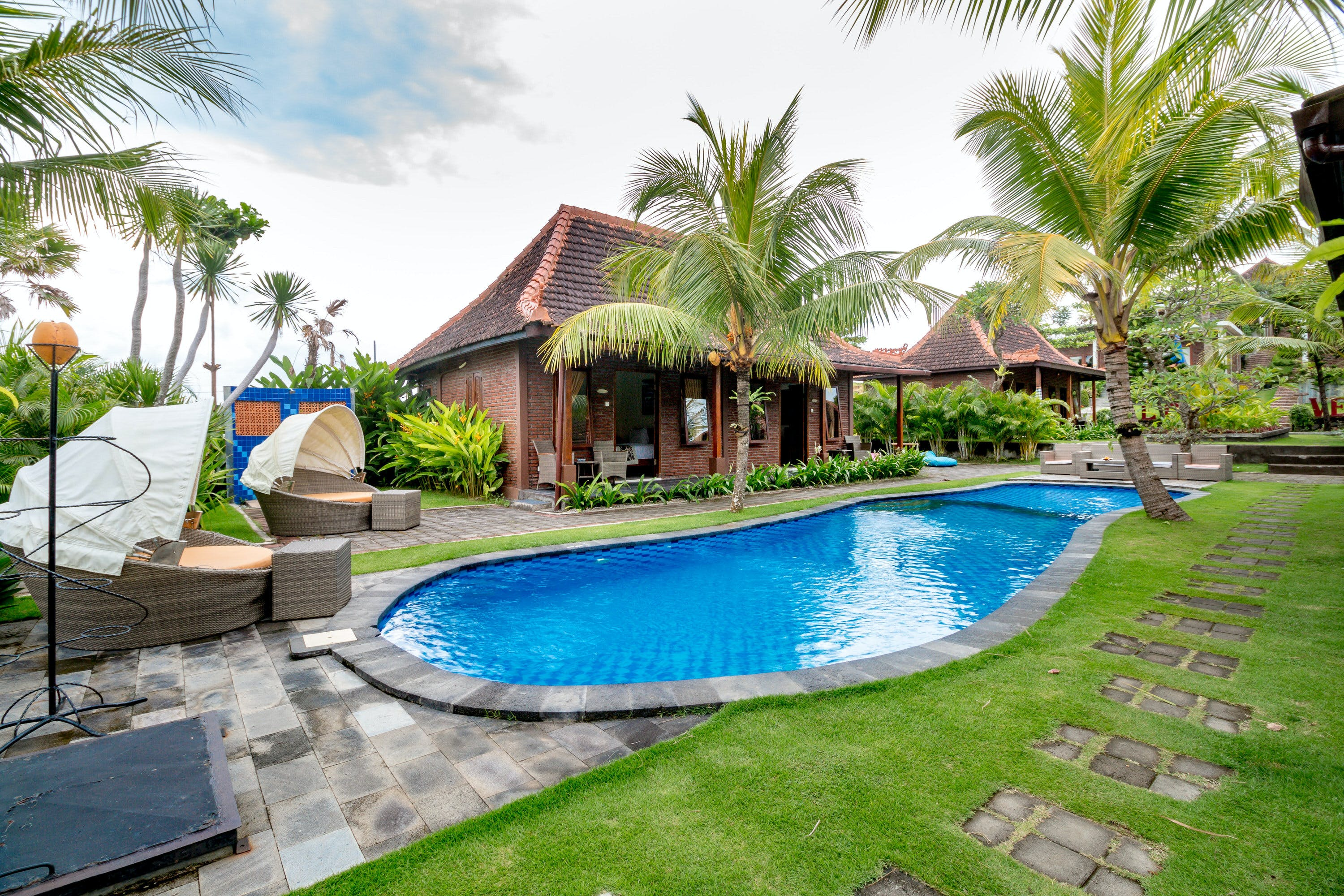 Front Pool Room at Sea Medewi Resort, best hotel for surfing, yoga, and enjoy Medewi beach in Negara