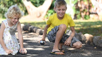 Kids playing petanque