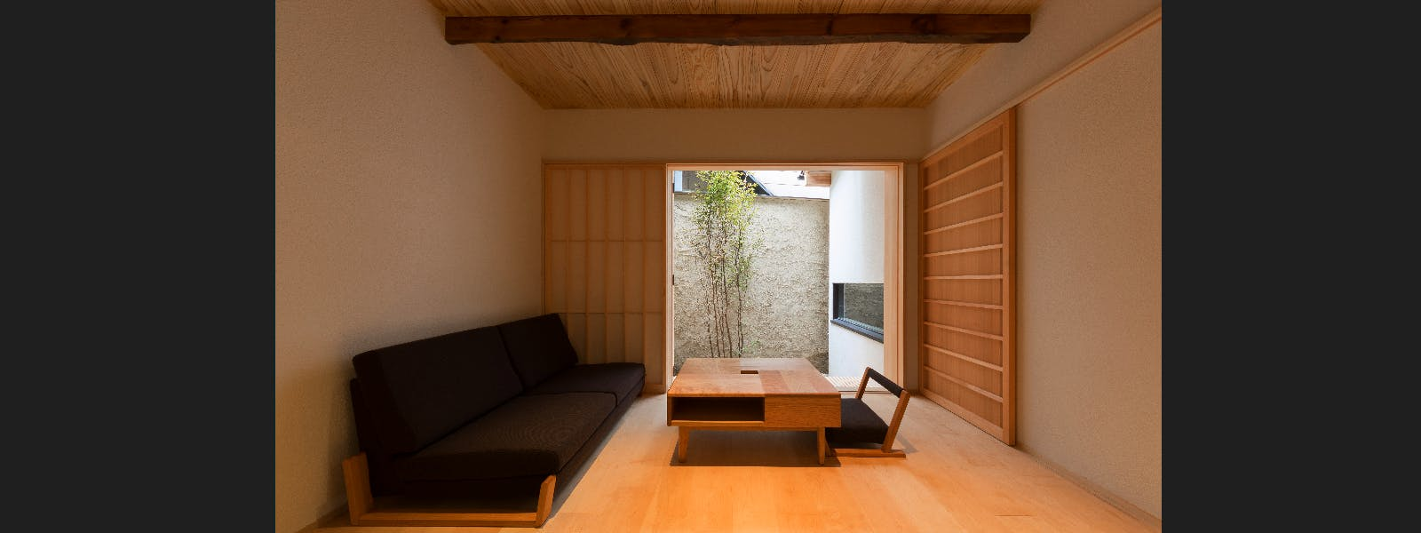 BenTen West Machiya in Kyoto - Living Area - featuring handmade furniture. Ideal for groups and families