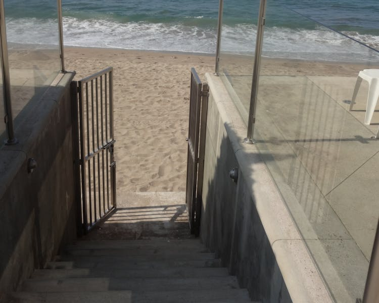 Steps to beach from property.