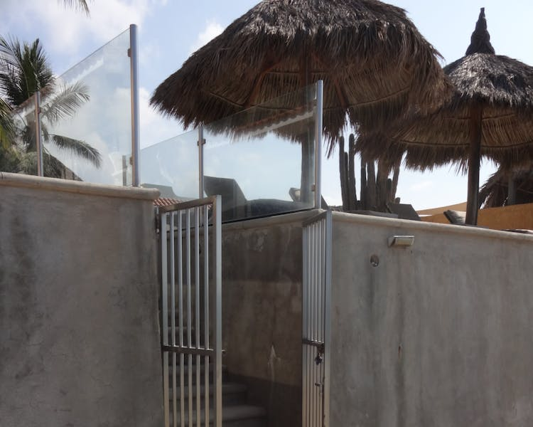 Gates to beach from property.