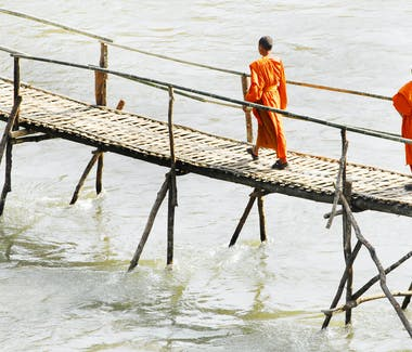 Luang Prabang wooden bridge monks