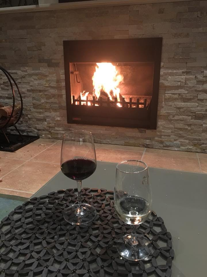Enjoy a glass of wine and the open fire.