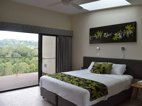 King sized bed that can be separated into two single beds. Private balcony with beautiful valley views.