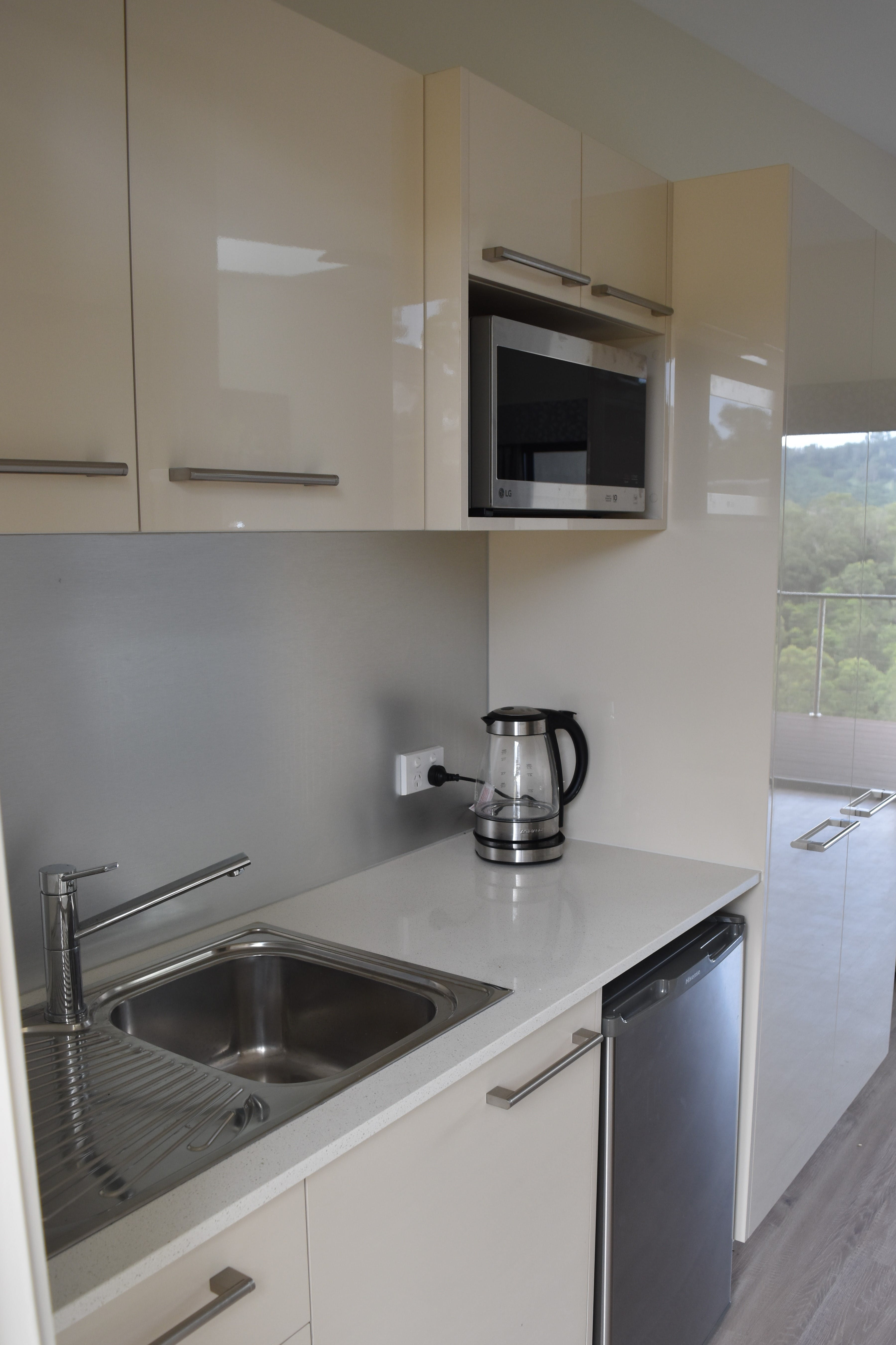 Kitchenette with bar fridge, microwave, kettle & toaster. Other electrical appliances are available for your use.