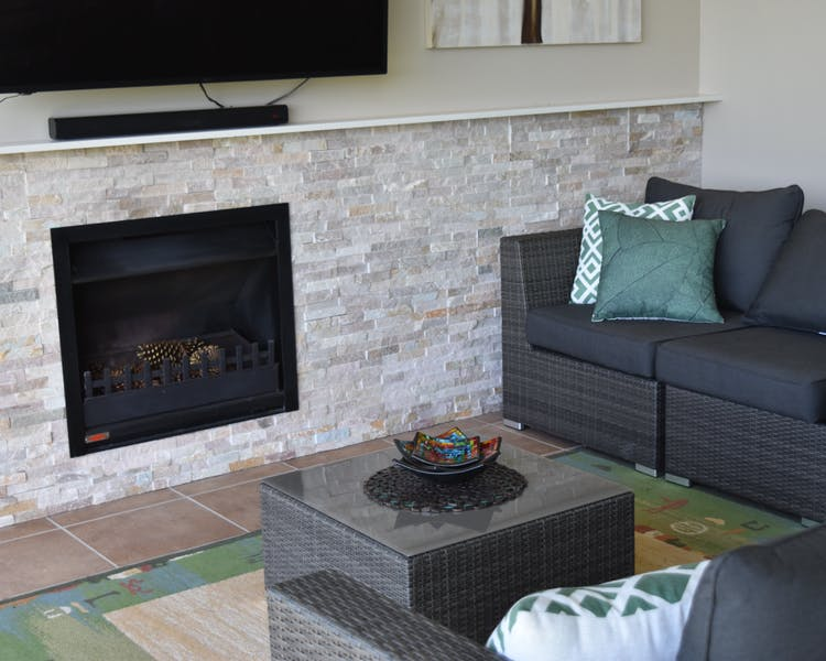Open wood fire place in guest lounge room.