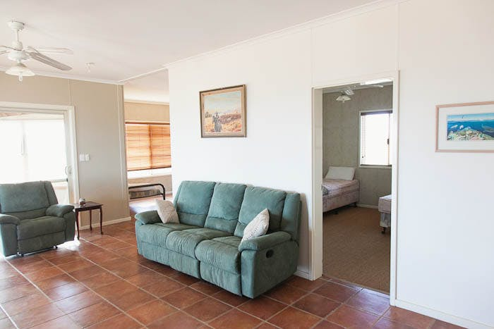 Warroora - Dudley Hill living area and bedroom with 2 single beds.