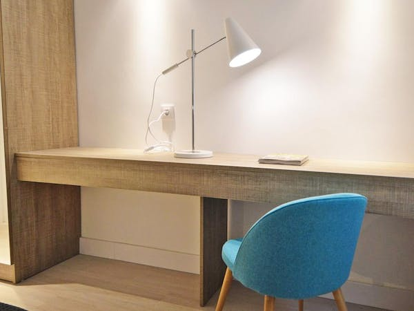 Work desk with reading light in each apartment