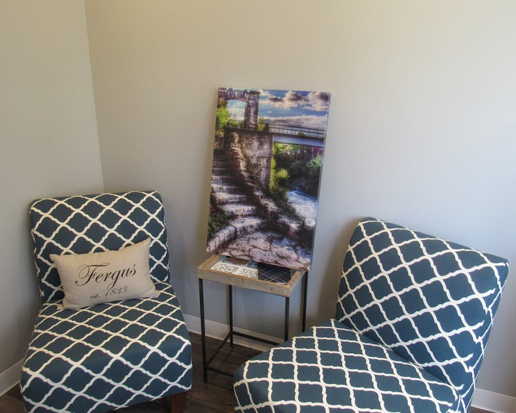 "Fergus Suite - seating are with 55"" TV. local photography from various artists are displayed in our suites."