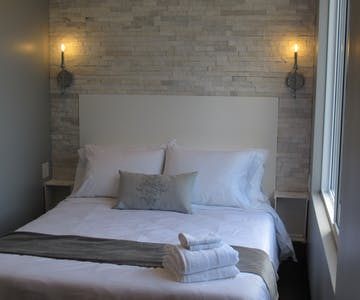 Soft and romantic. Stone headboard adds to the glamour of this room